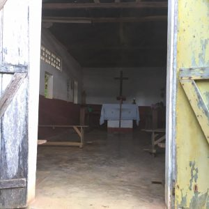 Forest Conservation Volunteers work with a little Church Village